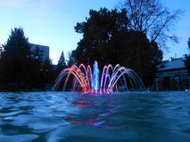 Colorful fountain in the night. Stock Photo
