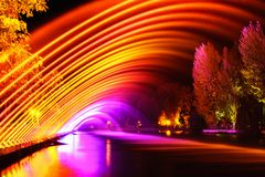 Colorful fountains in city park at night time, long exposure pho stock images