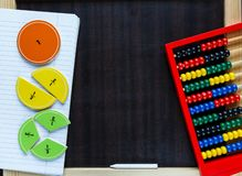 Colorful fractions in mathematics on the classboard. interesting math for kids. education, back to school. Concept stock image