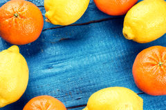 Colorful frame with citrus fruits - lemons and tangerines Stock Photo