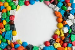 Colorful frame of multicolored candies on white background. Colorful frame of multicolored candies on white  background stock photo
