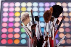 Colorful frame with various makeup products Stock Photo