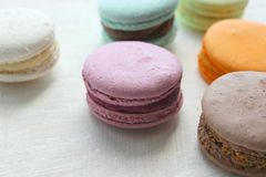 Colorful French or Italian macaroon stack cakes / Macaroon cakes. Assorted macaroon cakes stacked on top of each other on a light. Background. Copy space royalty free stock image