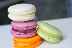 Colorful French or Italian macaroon stack cakes / Macaroon cakes. Assorted macaroon cakes stacked on top of each other on a light. Background. Copy space stock images