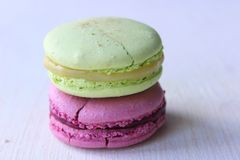 Colorful French or Italian macaroon stack cakes / Macaroon cakes. Assorted macaroon cakes stacked on top of each other on a light. Background. Copy space royalty free stock photos