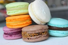 Colorful French or Italian macaroon stack cakes / Macaroon cakes. Assorted macaroon cakes stacked on top of each other on a light. Background. Copy space stock photos