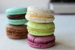 Colorful French or Italian macaroon stack cakes / Macaroon cakes. Assorted macaroon cakes stacked on top of each other on a light. Background. Copy space stock photography