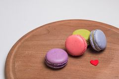 Colorful French Macarons on brown wooden Royalty Free Stock Photography