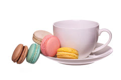 Colorful French Macarons with Cup of Tea isolated Stock Photography
