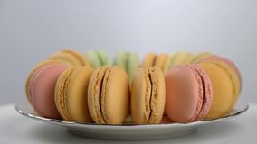 Colorful French macarons, gourmet dessert. Seamless loopable stock footage