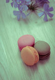 Colorful French macarons on wooden background Royalty Free Stock Image