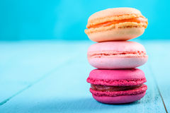 Colorful French Macaroons On Blue Stock Photos