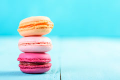 Colorful French Macaroons On Blue Stock Photography