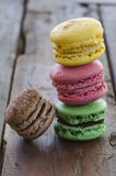 Colorful french macaroons on a dark wooden table Stock Photos