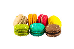 Colorful french macaroons. Isolated picture, Seven sweet colorful french macarons or macaroons on white background stock photography