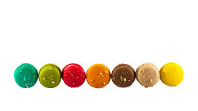 Colorful french macaroons. Isolated picture, Seven sweet colorful french macarons or macaroons on white background Stock Images