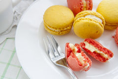 Colorful french macaroons in white dish with soft vintage color Royalty Free Stock Images