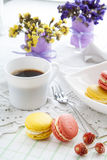 Colorful french macaroons in white dish with soft vintage color Stock Photo