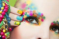 Colorful French manicure and makeup. Stock Photos
