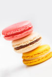 Colorful French pastry on a white background. Stock Photo