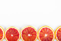 Colorful fresh citrus fruit on white background. Orange, tangerine, lime, blood orange, grapefruit. Fruit background. Summer food. Concept. Flat lay, top view royalty free stock photography