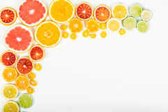 Colorful fresh citrus fruit on white background. Orange, tangerine, lime, blood orange, grapefruit. Fruit background. Summer food. Concept. Flat lay, top view stock image