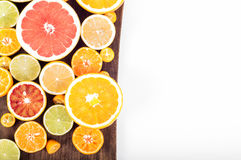 Colorful fresh citrus fruit on wooden background. Orange, tanger Royalty Free Stock Photos