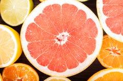 Colorful fresh citrus fruit on wooden background. Orange, tanger Royalty Free Stock Photo