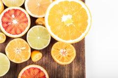 Colorful fresh citrus fruit on wooden background. Orange, tanger Royalty Free Stock Image