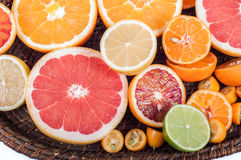 Colorful fresh citrus fruit on wooden background. Orange, tanger Royalty Free Stock Photography