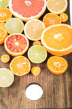 Colorful fresh citrus fruit on wooden background. Orange, tanger Stock Photo
