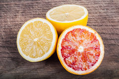 Colorful fresh citrus fruit on wooden background. Orange, tanger Stock Photography