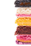 Colorful fresh delicious macaroons. Cut into half of colorful macaroons to show delicious fillings.  Copy space for your text Royalty Free Stock Image