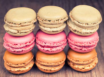 Colorful fresh delicious macaroons on wooden background Stock Photography