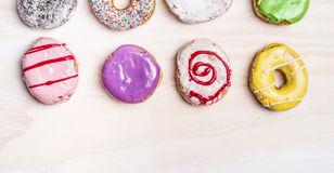 Colorful fresh donuts on white wooden background. Colorful fresh donuts white wooden background stock images