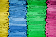 Colorful fresh dry towels. Stock Photos