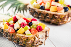 Colorful Fresh Fruit Salad in Pineapple Boat Stock Images
