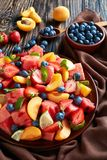 Colorful fresh fruit salad, top view stock images