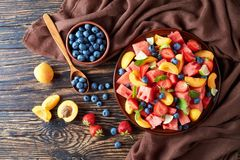 Colorful fresh fruit salad, top view stock photography