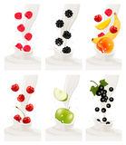 Colorful fresh fruits falling into the milky splash. Stock Image