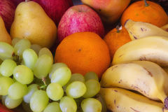 Colorful fresh fruits. A set of grapes, oragnes, bananas, apples and other fruits Stock Photography