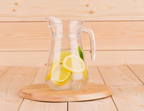 Colorful fresh lime and lemon fruit in carafe. Stock Images