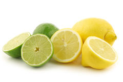 Colorful fresh lime and lemon fruit. And some cut ones on a white background Royalty Free Stock Photo