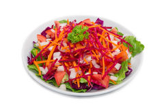 Colorful fresh vegetable salad on white background royalty free stock images