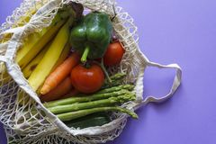 Fresh vegetables and fruit in reusable shopping bag royalty free stock image