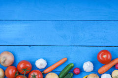 Colorful fresh vegetables on table. Colorful fresh vegetables on blue wooden table Royalty Free Stock Photo