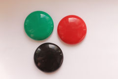 Colorful fridge magnets on a white background. Bright magnets in the form of balls Stock Photography
