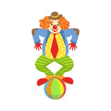 Colorful Friendly Clown Balancing On Ball In Classic Outfit Stock Photography