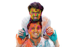 Colorful Friends. A portrait of two Indian friends with their faces traditionally covered, during HOLI festival Stock Photo