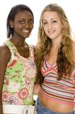 Colorful Friends. Two attractive young women in colorful patterned tops Stock Image